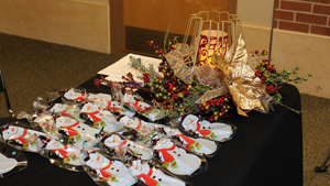 photo of a decorated table with snowman cookies and holly